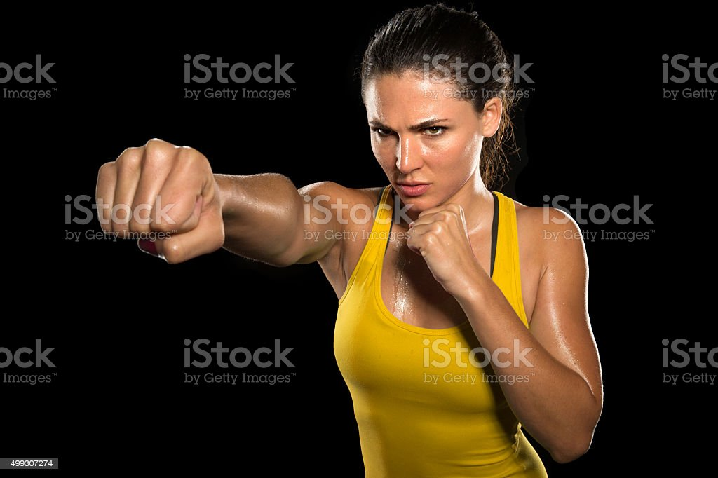 MMA woman fighter tough chick boxer punch pose exercise training stock photo