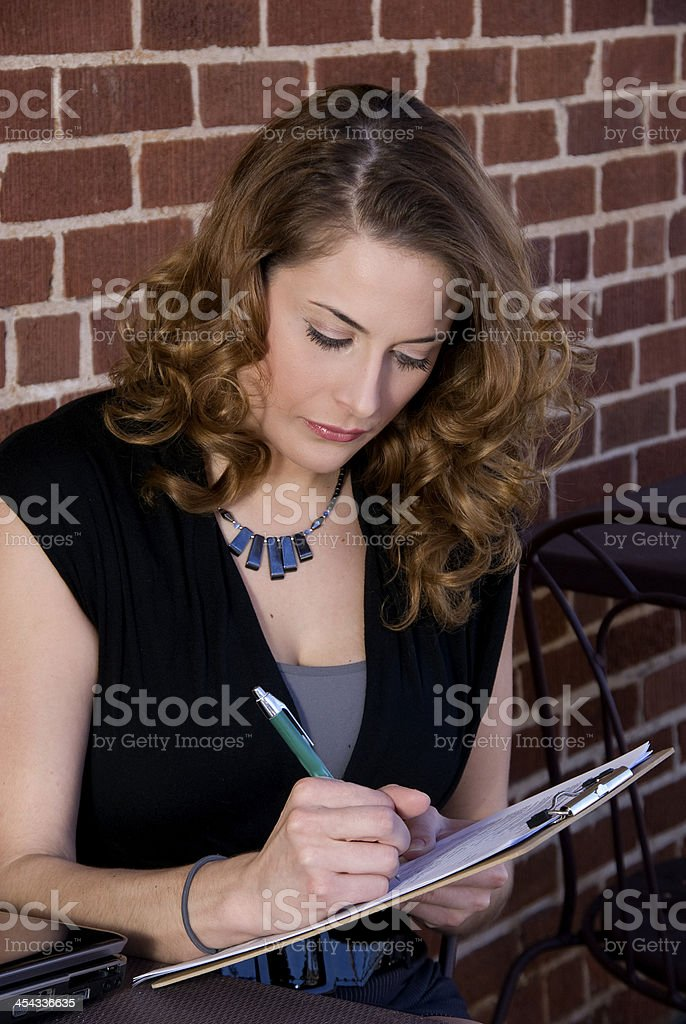 Woman Filing Out a Form royalty-free stock photo