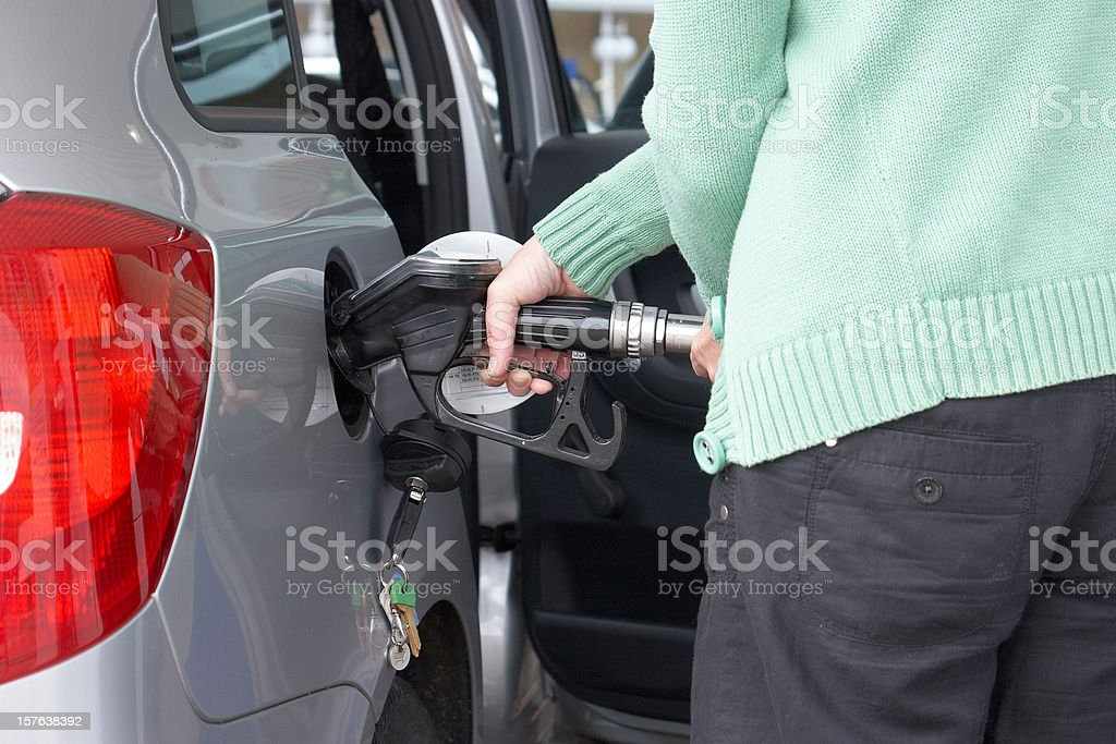 Woman filling up the car pump focus royalty-free stock photo