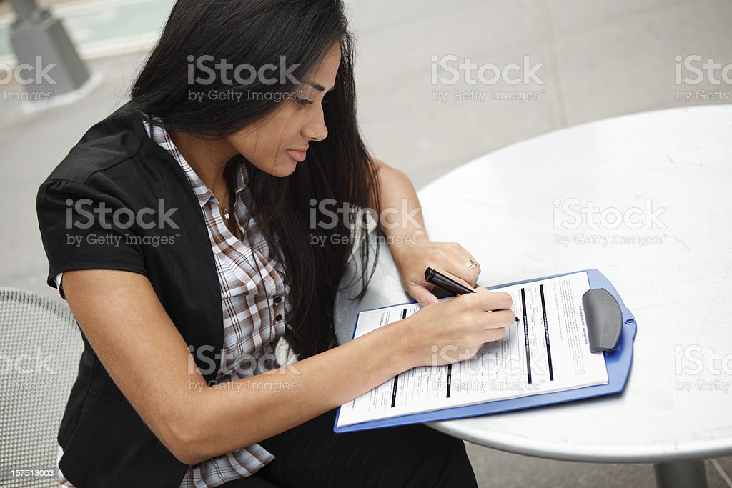 Woman Fills Out Loan Application royalty-free stock photo