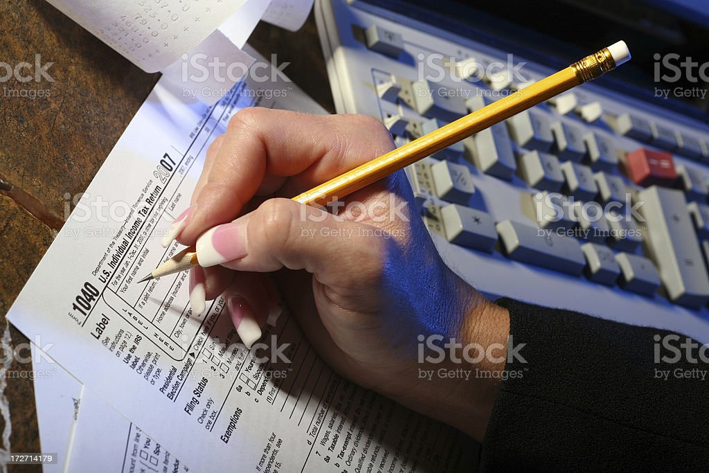 Woman fills out Tax form 1040 royalty-free stock photo