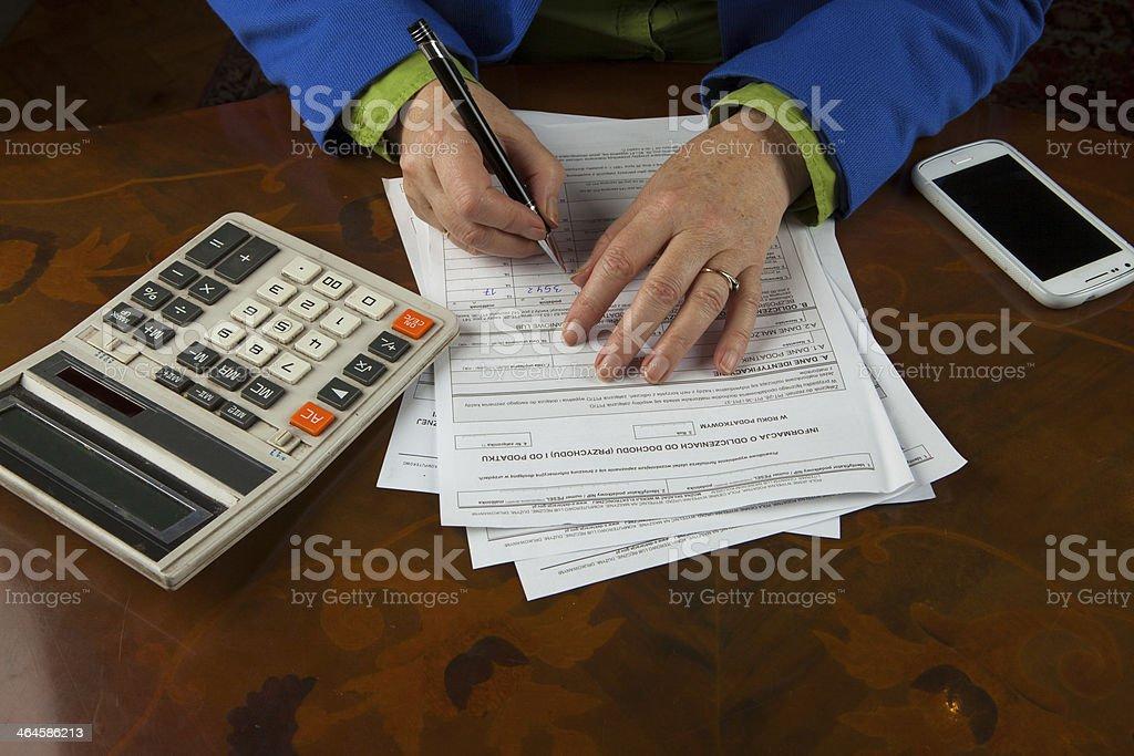 Woman fills tax return stock photo