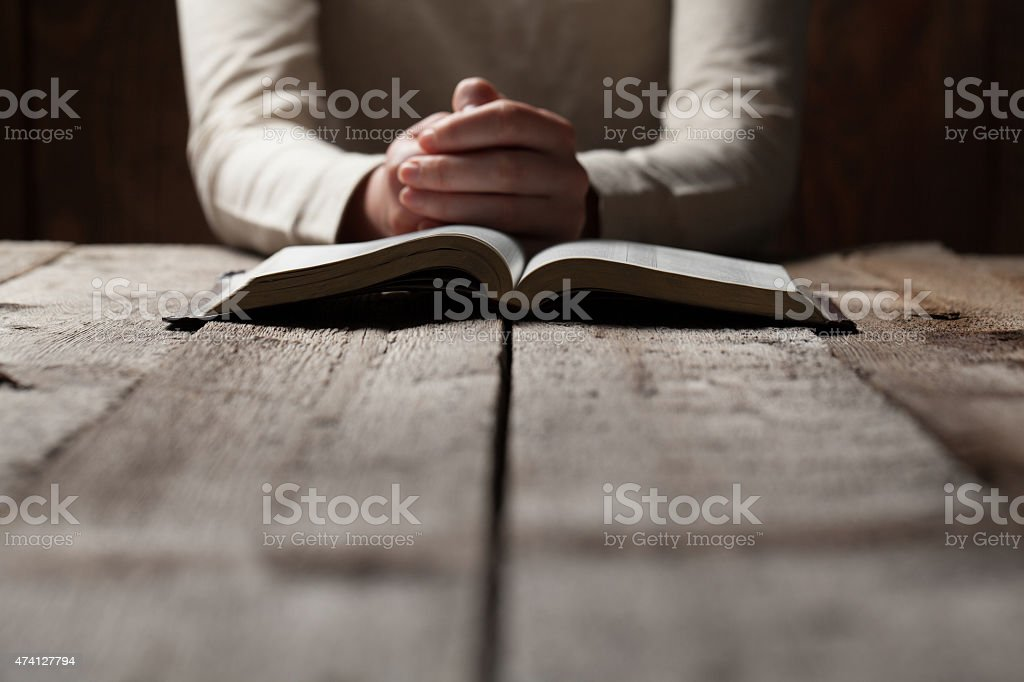 woman finger presses on bible book stock photo