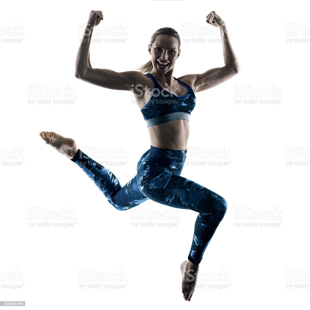 woman fitness excercises jumping silhouette stock photo