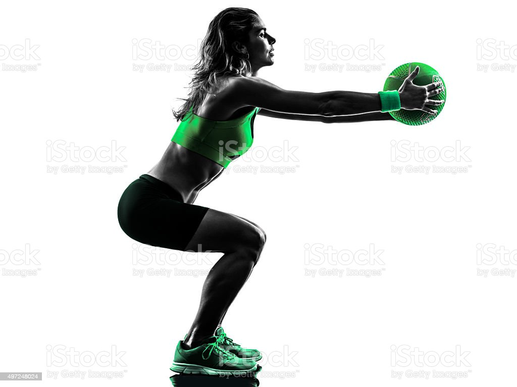 woman fitness Medicine Ball exercises silhouette stock photo