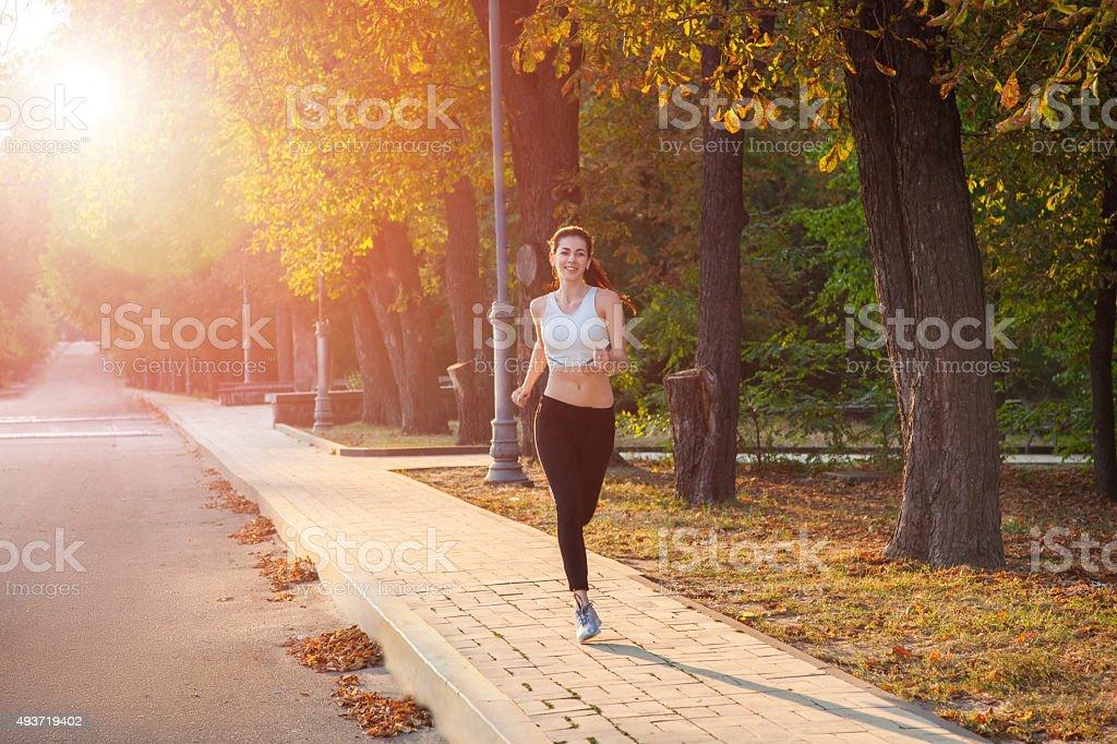 woman fitness sunrise jogging workout wellness concept. stock photo
