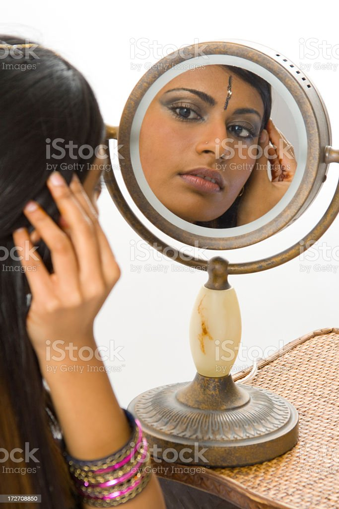 Woman fixing her hair royalty-free stock photo
