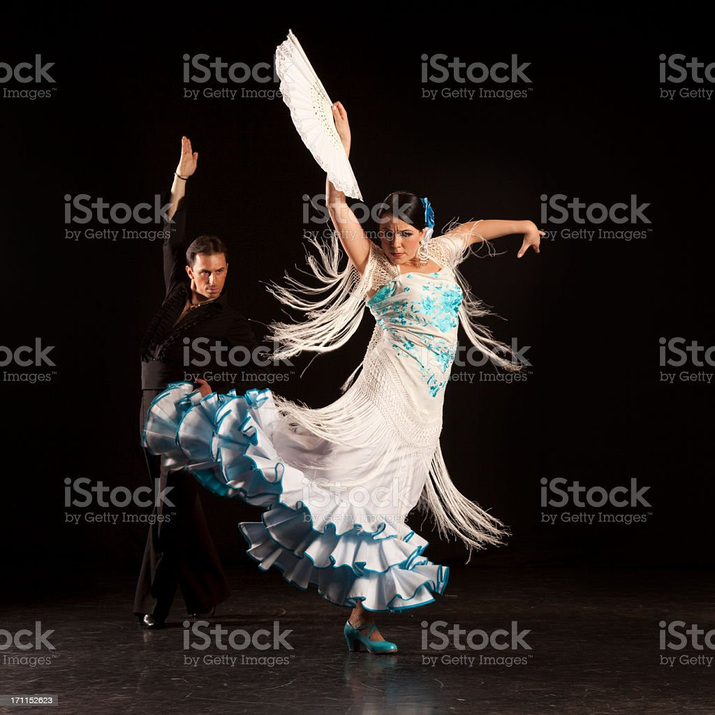 Woman flamenco dancer in blue and white with her partner stock photo