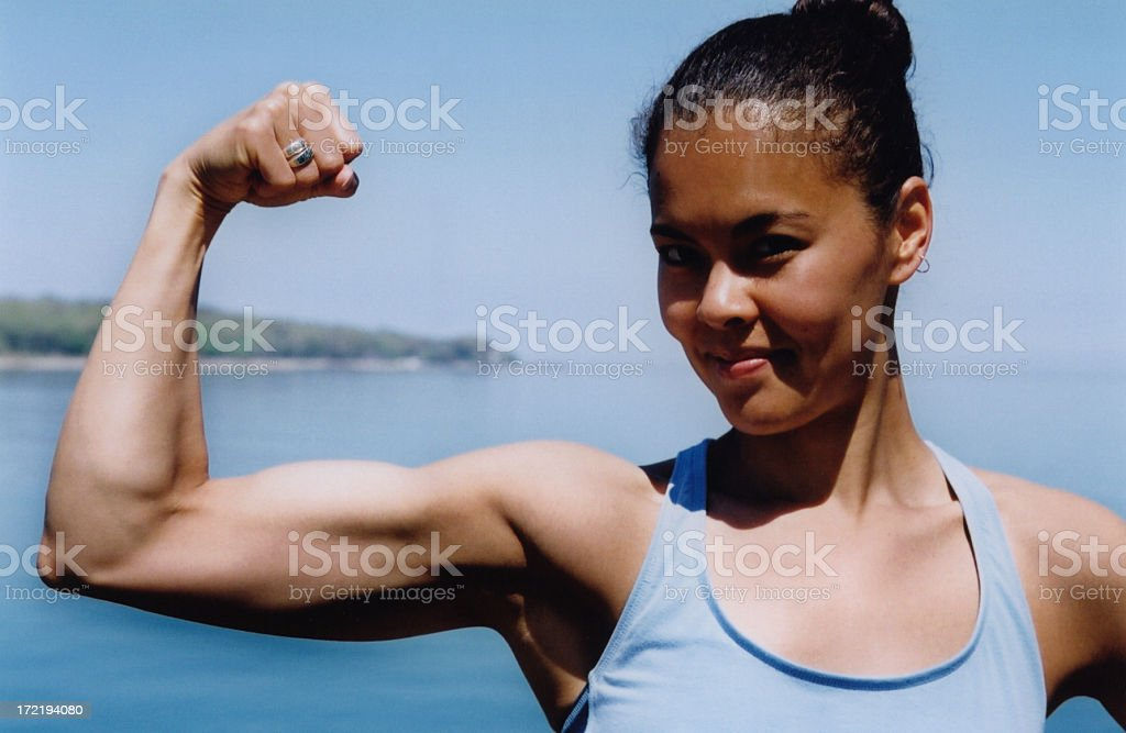 Woman Flexing Bicep royalty-free stock photo