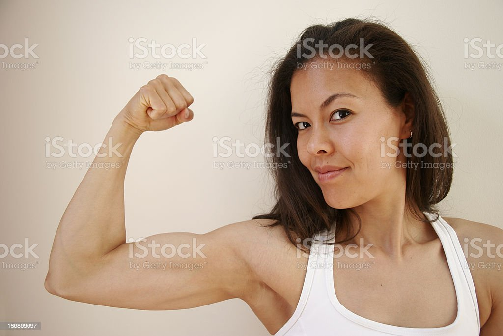Woman Flexing Bicep royalty-free stock photo