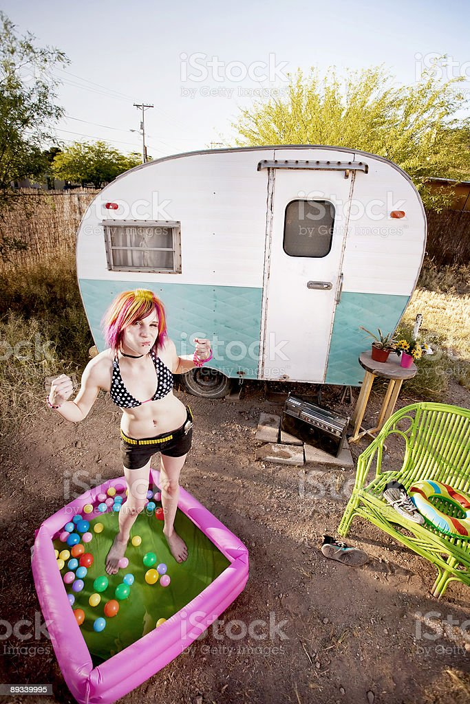 Woman flexing in a play pool stock photo