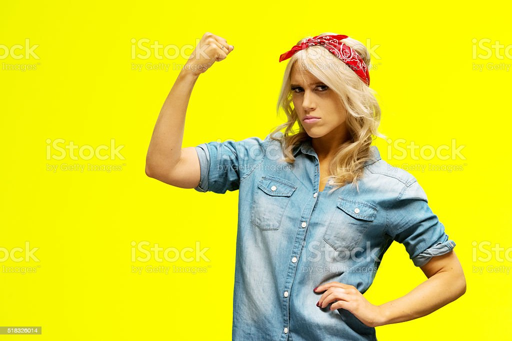 Woman flexing muscle stock photo
