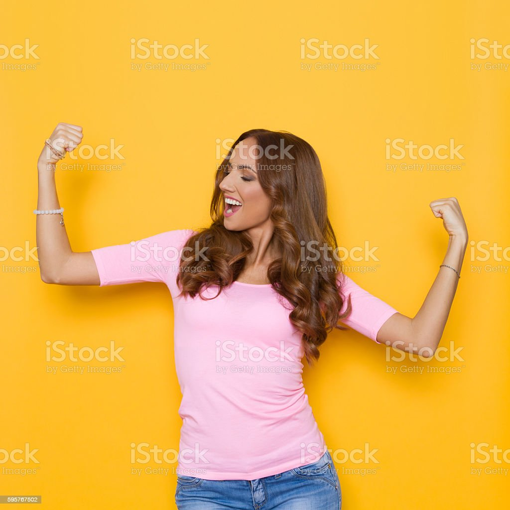 Woman Flexing Muscles And Looking Away stock photo
