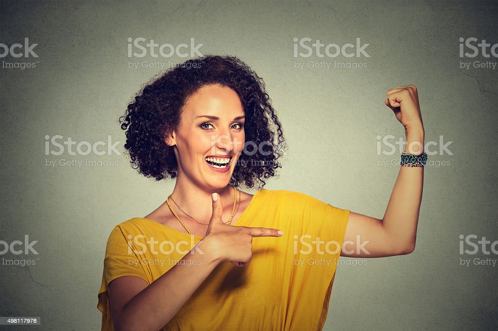 woman flexing muscles confident showing her strength stock photo