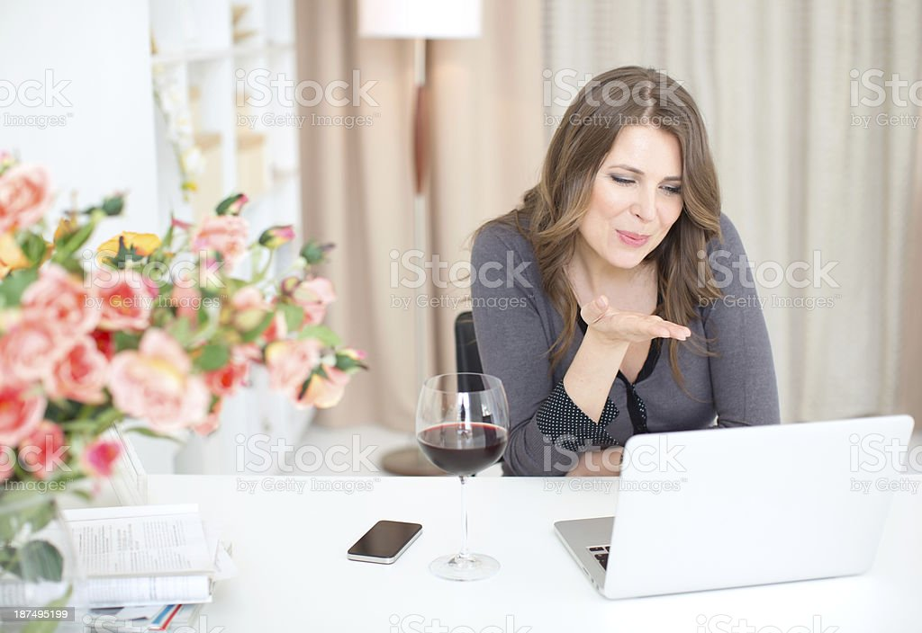 Woman flirting on internet. royalty-free stock photo