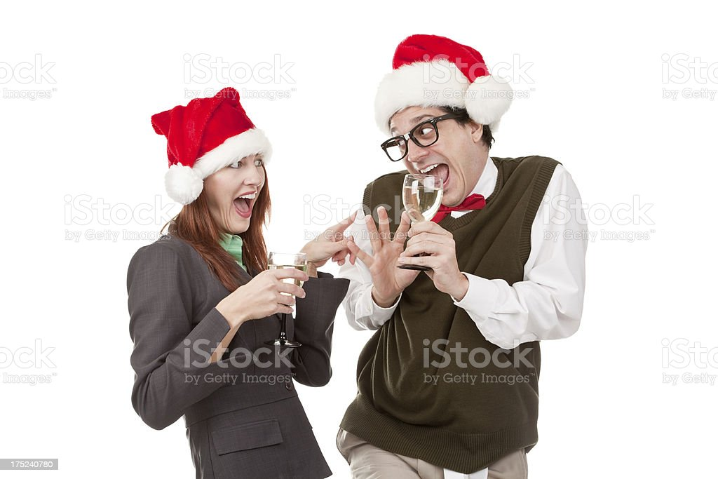 Woman Flirting With Nerdy Coworker at Christmas Party royalty-free stock photo