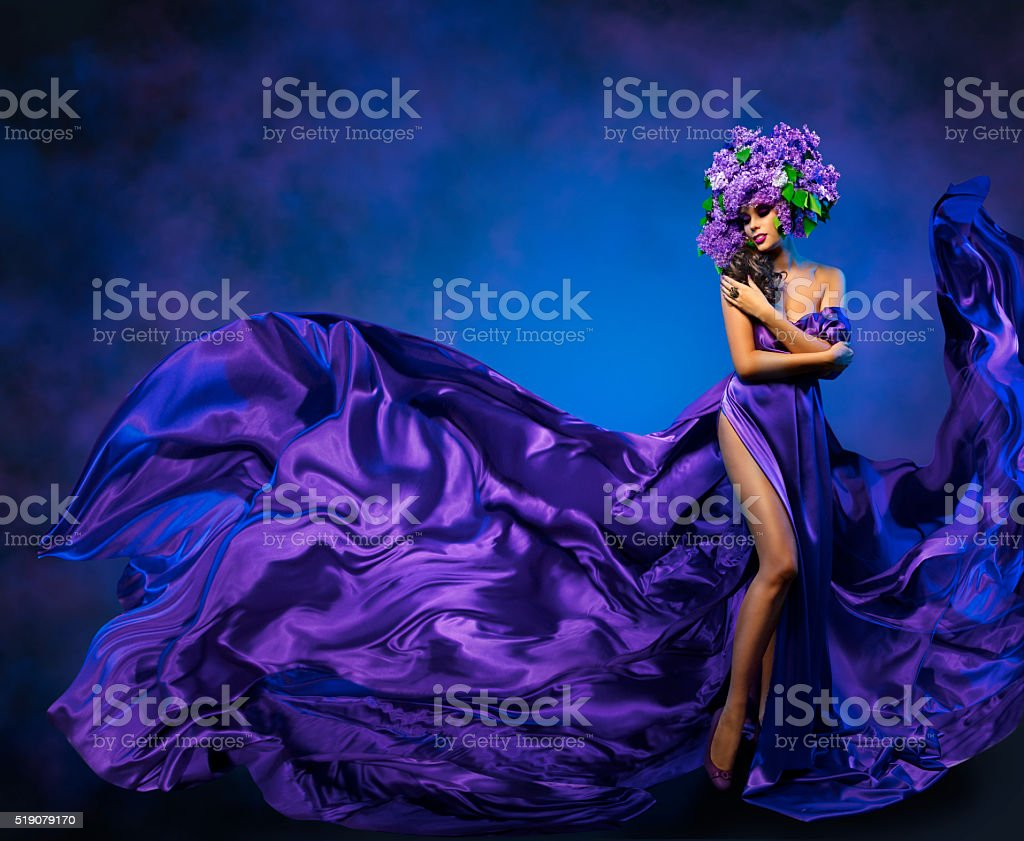 Woman Flower Dress Flying Fabric, Beauty Fashion Model Lilac Crown stock photo