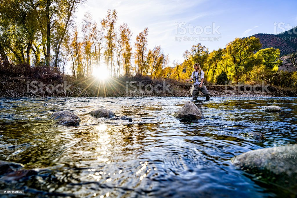 Woman Fly Fishing Eagle River stock photo
