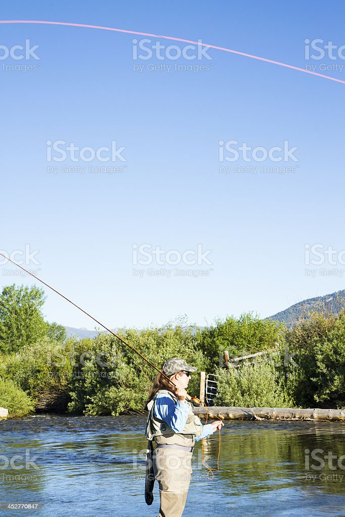 Woman Fly Fishing In A Mountain Steam royalty-free stock photo