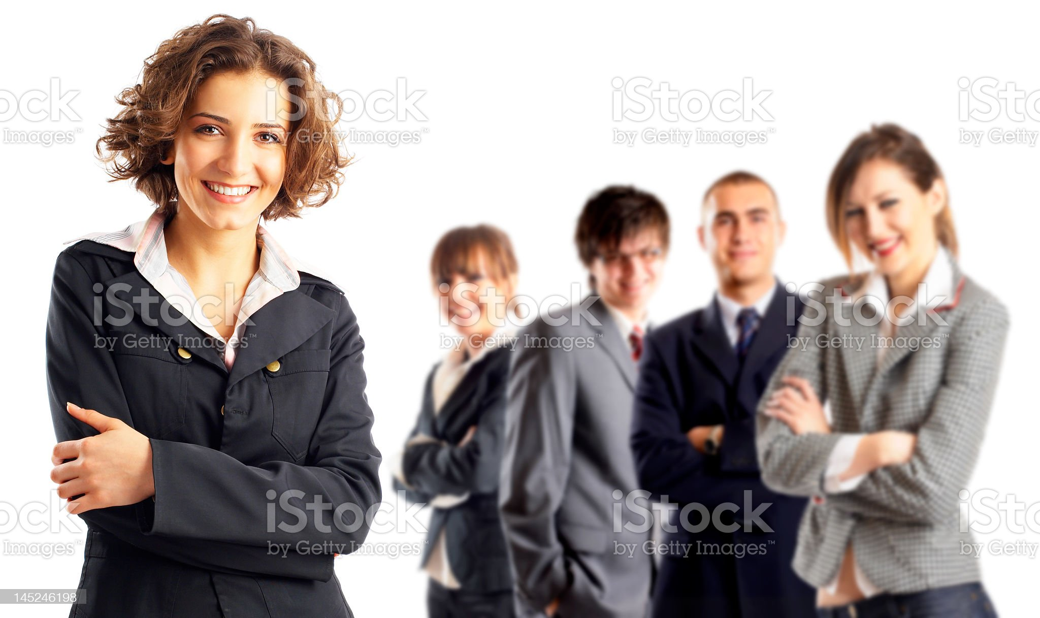 A woman focused in on with four colleagues in the background royalty-free stock photo