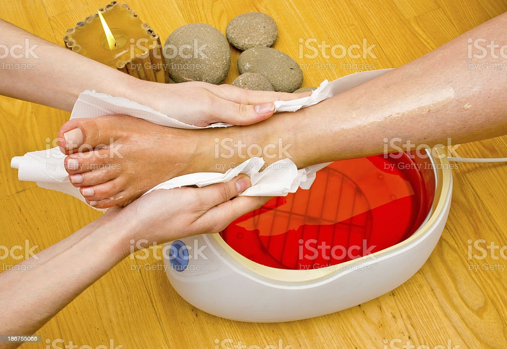 woman foot in paraffin bath at the spa royalty-free stock photo