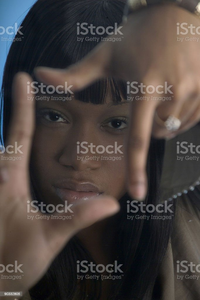 Woman framing face with her fingers royalty-free stock photo