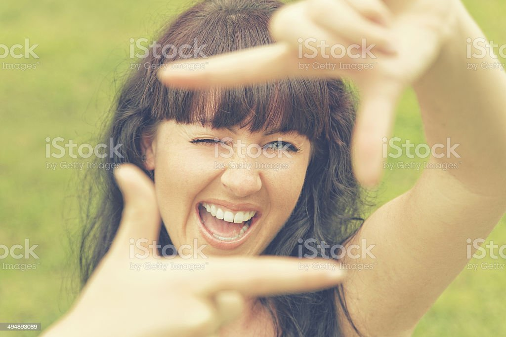 Woman framing with imaginable camera (xxxl) stock photo