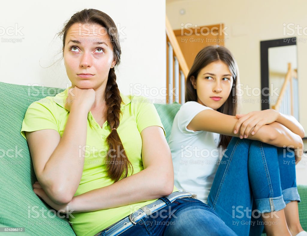 Woman friends sitting and discontent stock photo