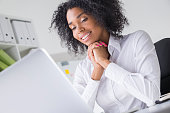 woman from Africa is looking at laptop screen in of