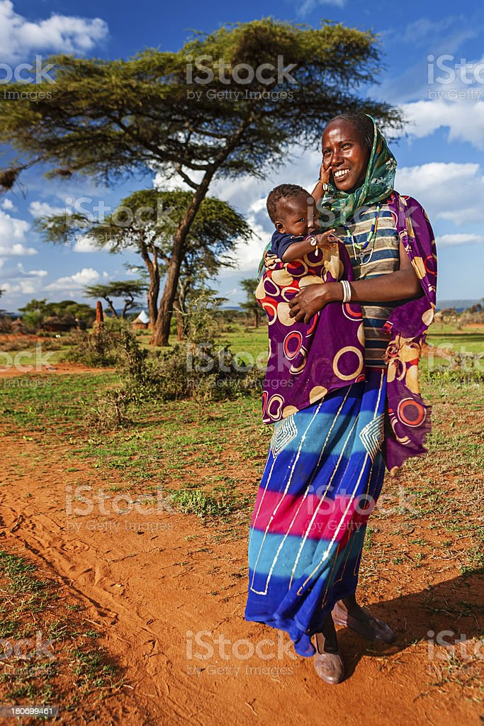 Woman from Borana tribe holding her baby, Ethiopia, Africa royalty-free stock photo
