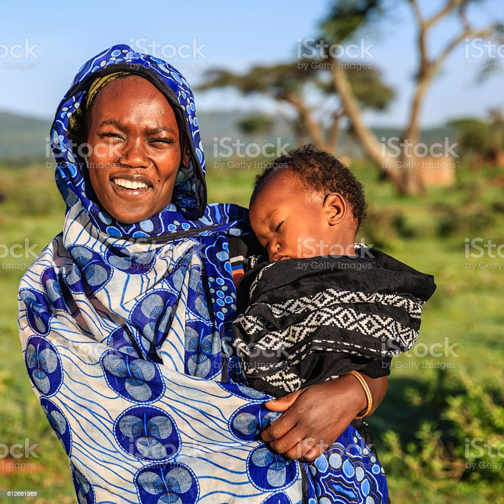 Woman from Borana tribe holding her baby, Ethiopia, Africa stock photo