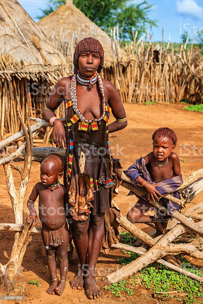 Woman from Hamer tribe with her children, Ethiopia, Africa stock photo