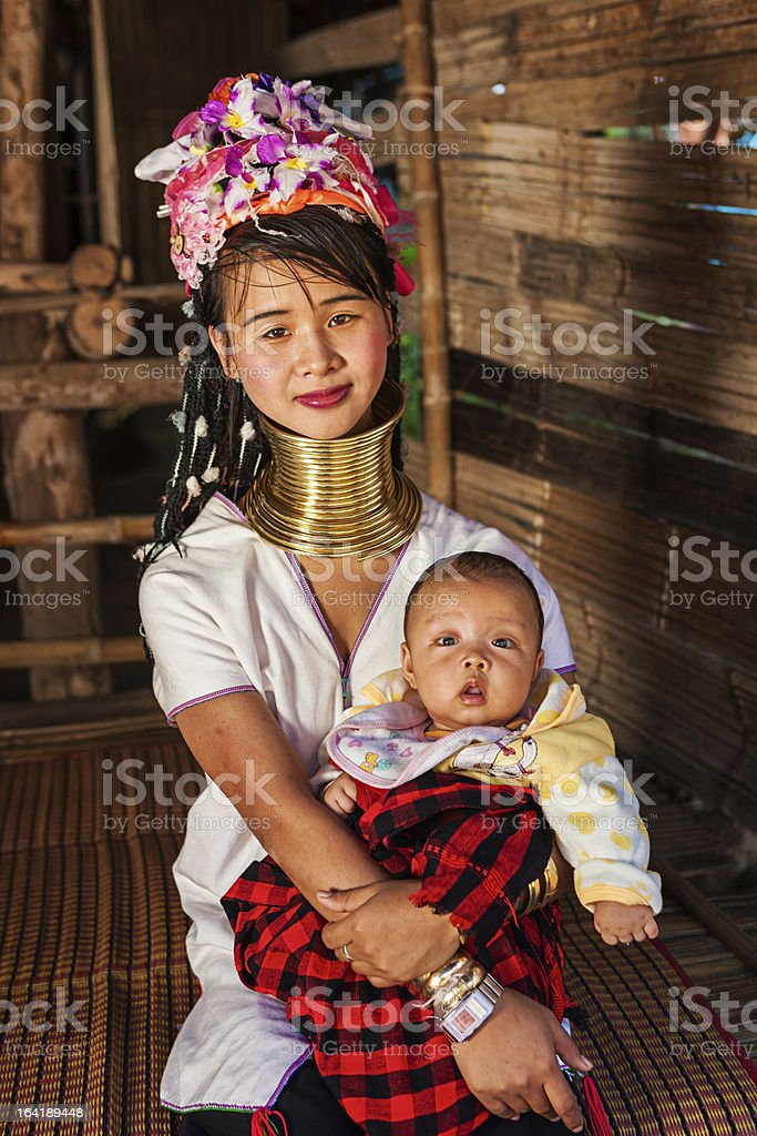 Woman from Long Neck Karen Tribe with her baby royalty-free stock photo