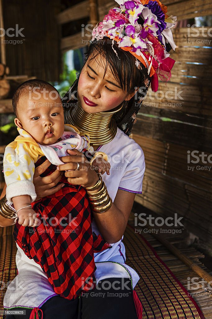 Woman from Long Neck Karen Tribe with her baby stock photo