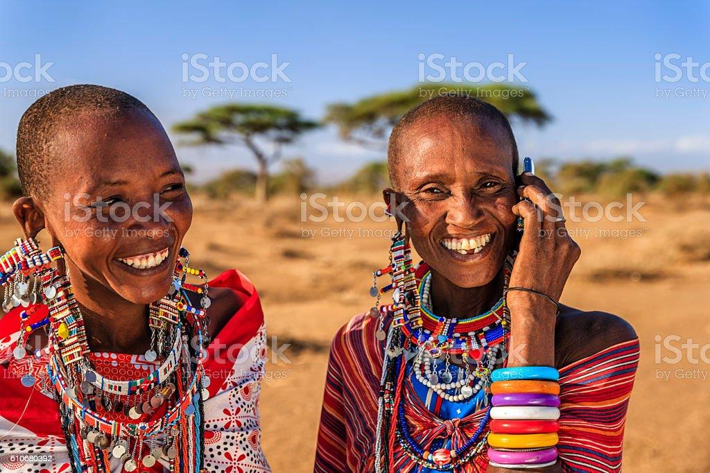 Woman from Maasai tribe using mobile phone, Kenya, Africa stock photo