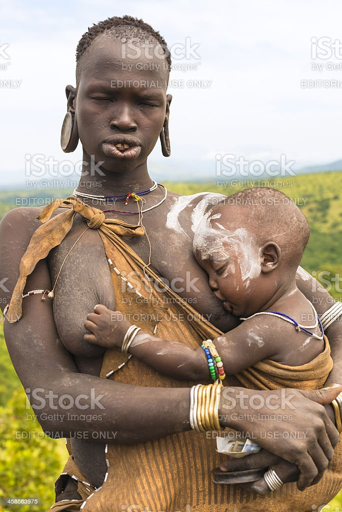 Woman from Mursi tribe stock photo