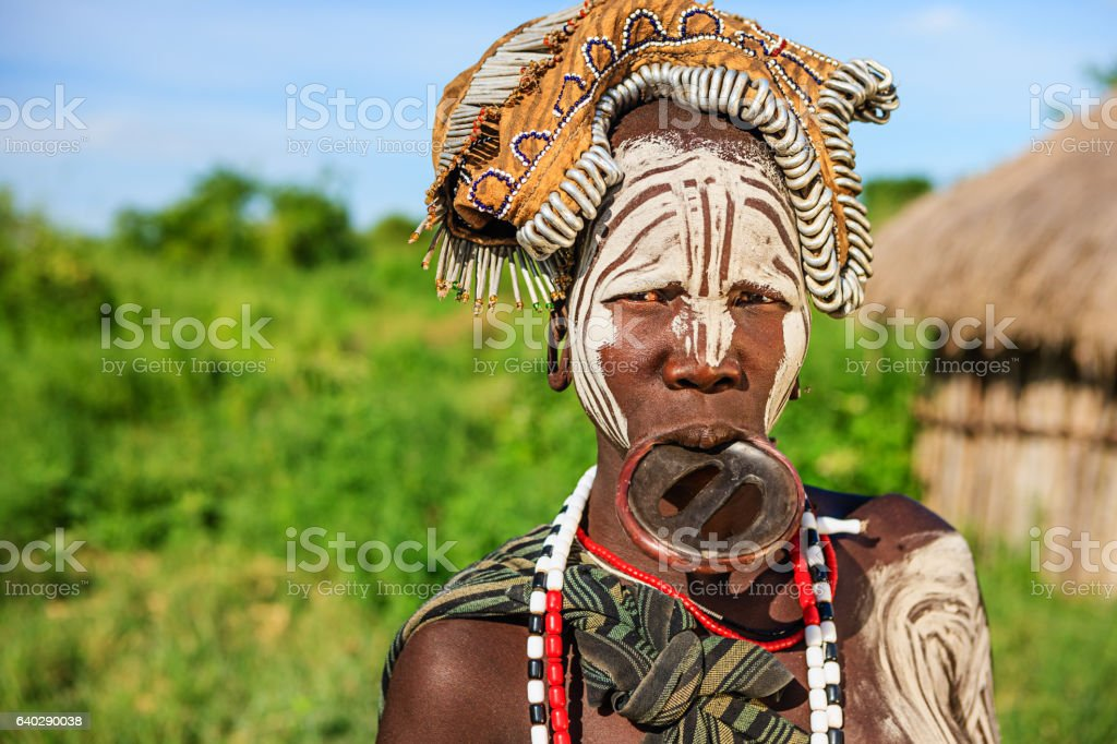 Woman from Mursi tribe with face paint, Ethiopia, Africa stock photo