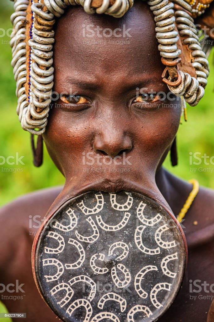 Woman from Mursi tribe with lip plate, Ethiopia, Africa stock photo