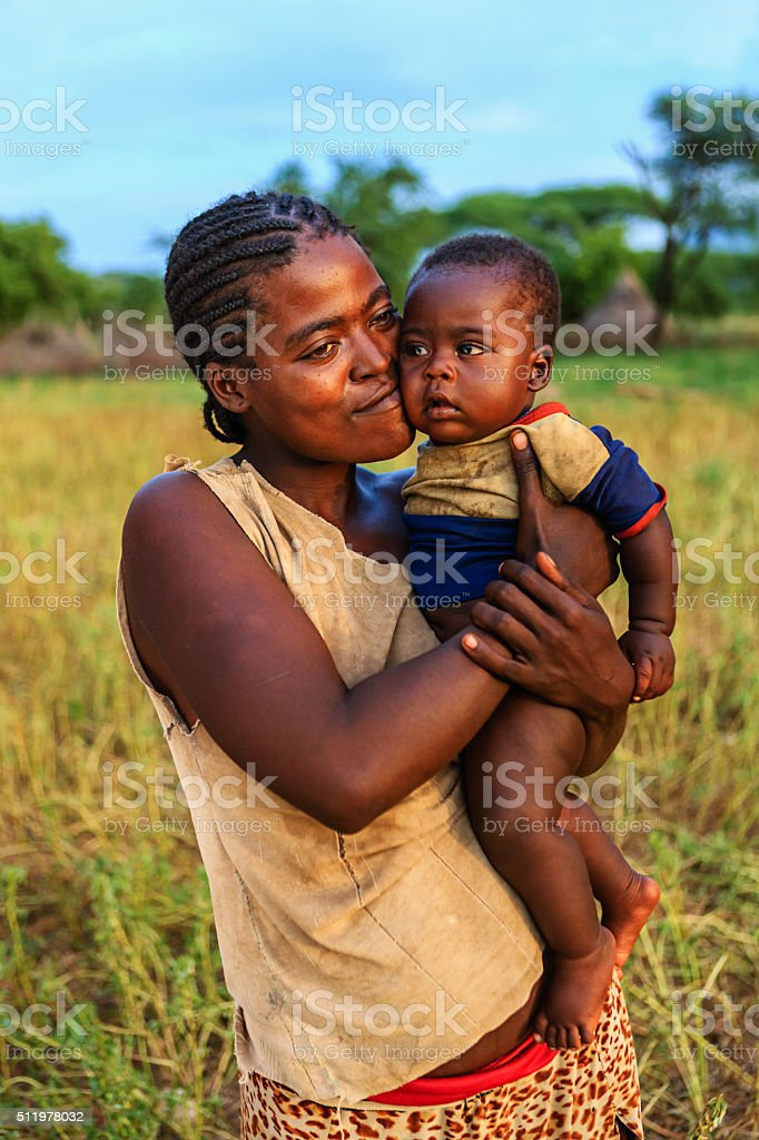 Woman from Samai tribe holding her baby, Ethiopia, Africa stock photo