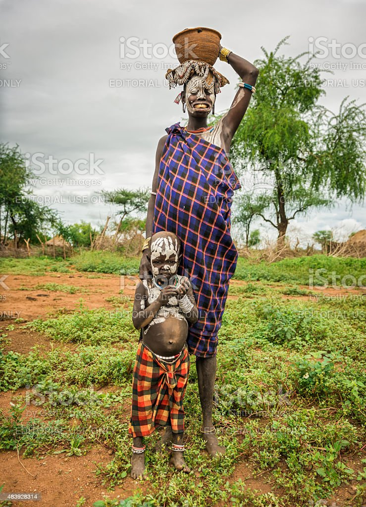 Woman from the african tribe Mursi with her baby, Ethiopia stock photo