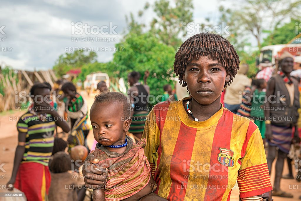 Woman from the Hamar tribe with her child in Ethiopia stock photo