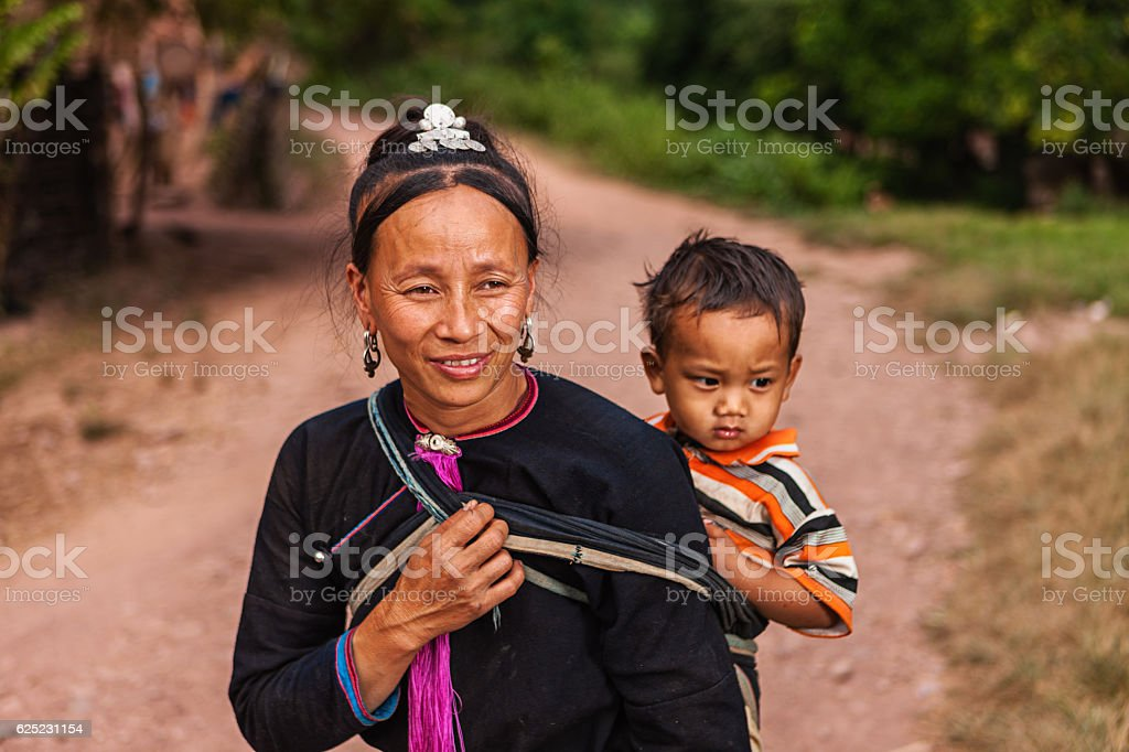 Woman from the hill tribe carrying her baby stock photo