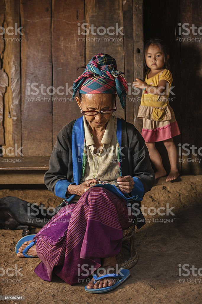 Woman from the hill tribe sewing a pillow royalty-free stock photo
