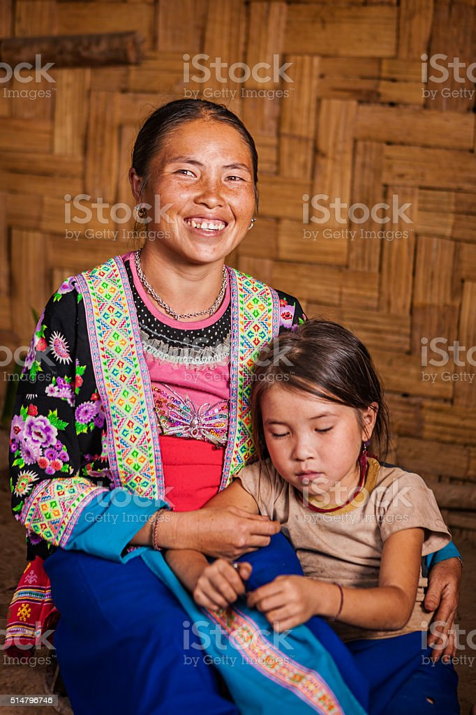 Woman from the hill tribe with her daughter stock photo