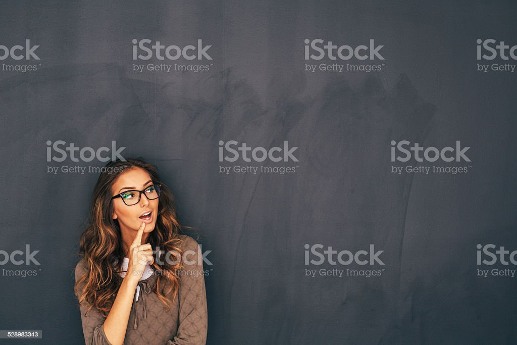 Woman Front of Blackboard stock photo