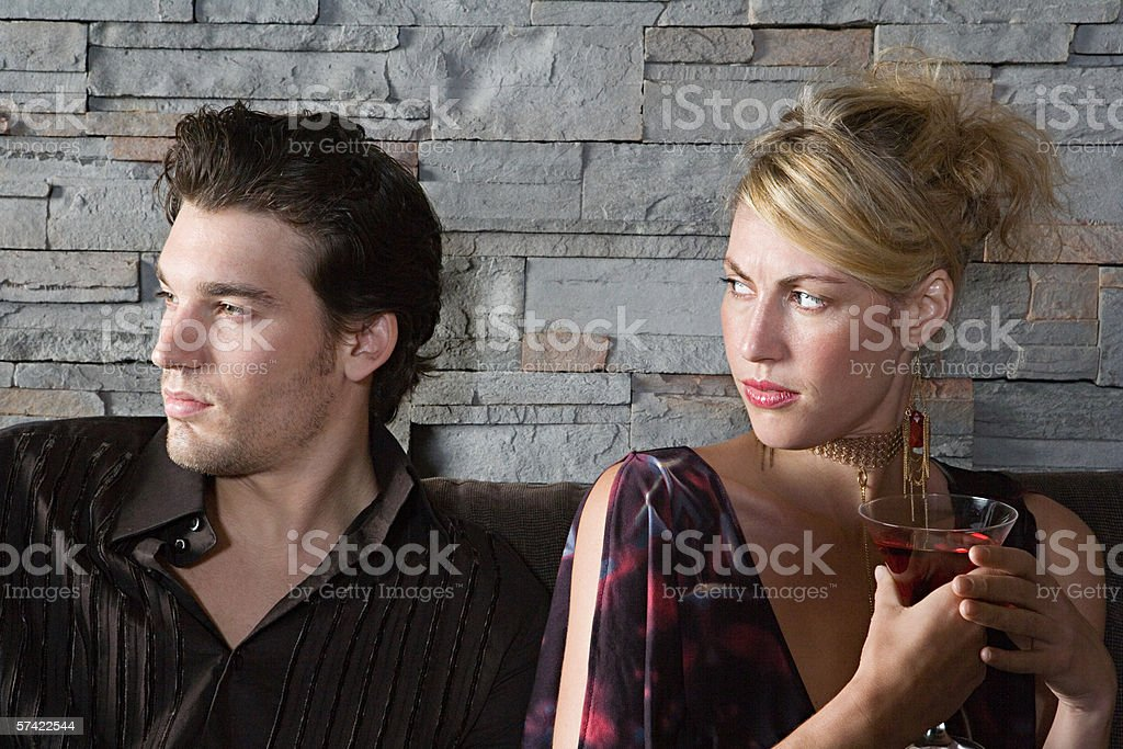 Woman frowning at boyfriend stock photo