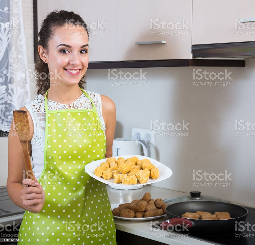 woman frying filled croquettes stock photo