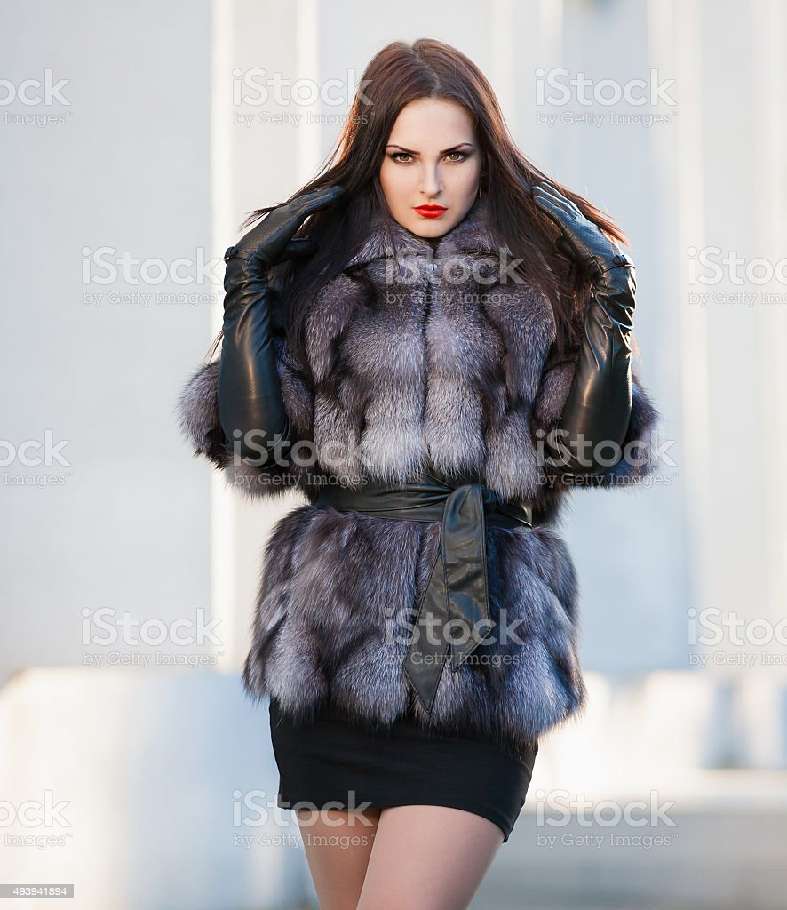 Black leather gloves with fur - Woman Fur Coat And Black Leather Gloves Royalty Free Stock Photo