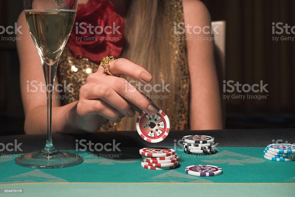 Woman gambling at the casino stock photo