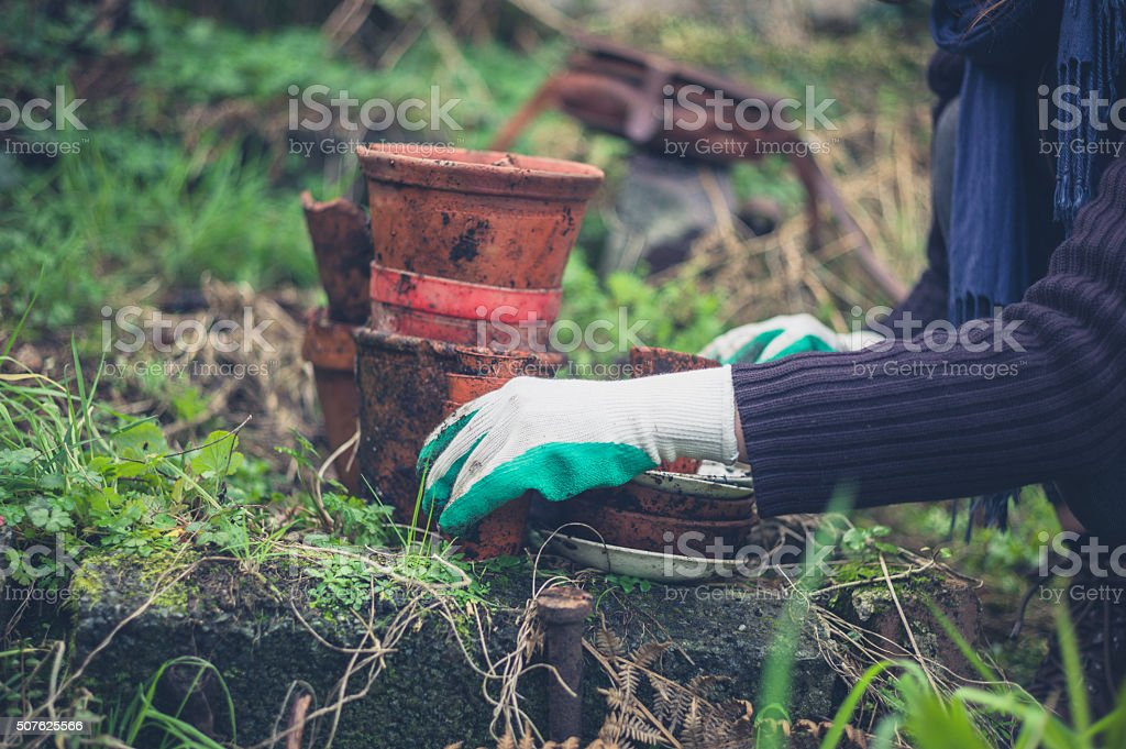 Woman gardening with pots stock photo